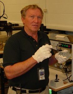 Bill Ellingson works on test samples of the reduced carbon cerbon material in the NASA laboratory.