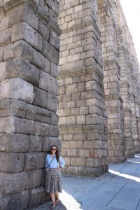 Jackie Kester in front of stone wall