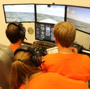 Students in flight simulation