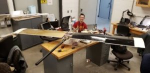 Student constructing drone